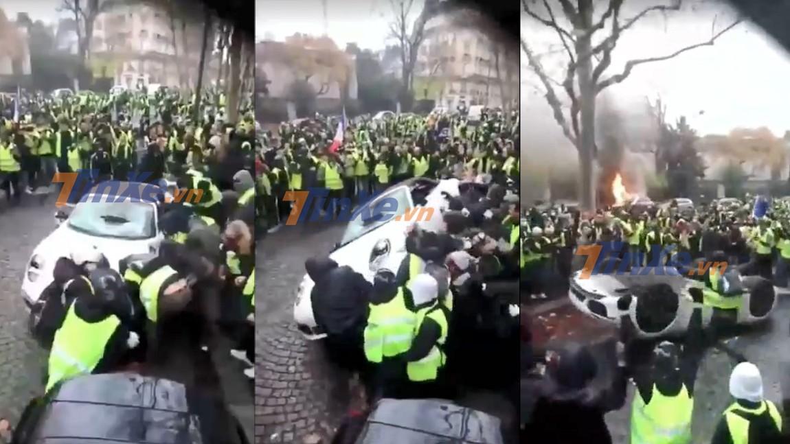 Đám đông vây quanh đẩy chiếc xe Porsche mui trần ngửa bụng