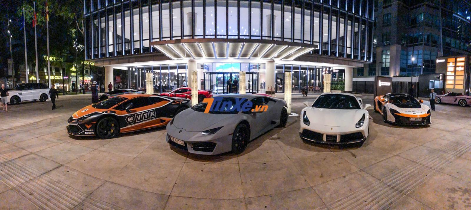 Để chuẩn bị đi dự tiệc khai trương đại lý Aston Martin Việt Nam, chủ nhân của 2 chiếc Lamborghini Huracan đã dán đổi màu ngoại thất