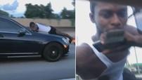 Nữ tài xế lái Mercedes-Benz C-Class ở vận tốc 112 km/h với bạn trai bám trên nắp capô