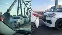 SUV hạng sang Lexus cùng 2 xe ô tô dồn toa trên cầu Chương Dương