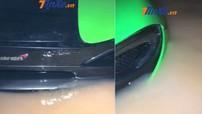Xót xa với video siêu xe McLaren 570S màu xanh cốm bị nước lũ nhấn chìm trong một hầm đỗ xe