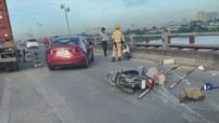 Hà Nội: Tai nạn giữa xe container với 2 xe máy khiến cầu Thanh Trì ùn tắc giao thông nghiêm trọng