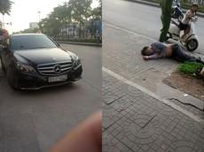 Say rượu, người đàn ông đi Mercedes E-Class bỏ xuống vỉa hè để ngủ