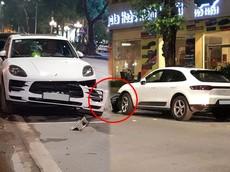 Hà Nội: Porsche Macan hơn 3,1 tỷ đồng đỗ trên đường bị xe khác va quẹt khiến cản va trước bung ra