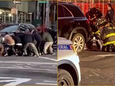 Cảm phục cả tá người đi đường chung tay nâng chiếc Mercedes-Benz để giải cứu nạn nhân mắc kẹt bên dưới