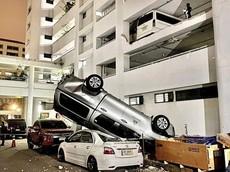Đẩy Toyota Hilux từ tầng 3 của bãi đỗ xe xuống đất, tài xế Honda CR-V bỏ trốn khỏi hiện trường