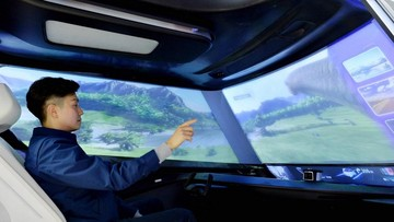 Kính chắn gió của xe tương lai có thể là một màn hình khổng lồ để chiếu phim và giải trí