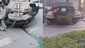 Hải Phòng: Taxi đâm vào vỉa hè rồi lật ngửa khiến 2 người mắc kẹt bên trong