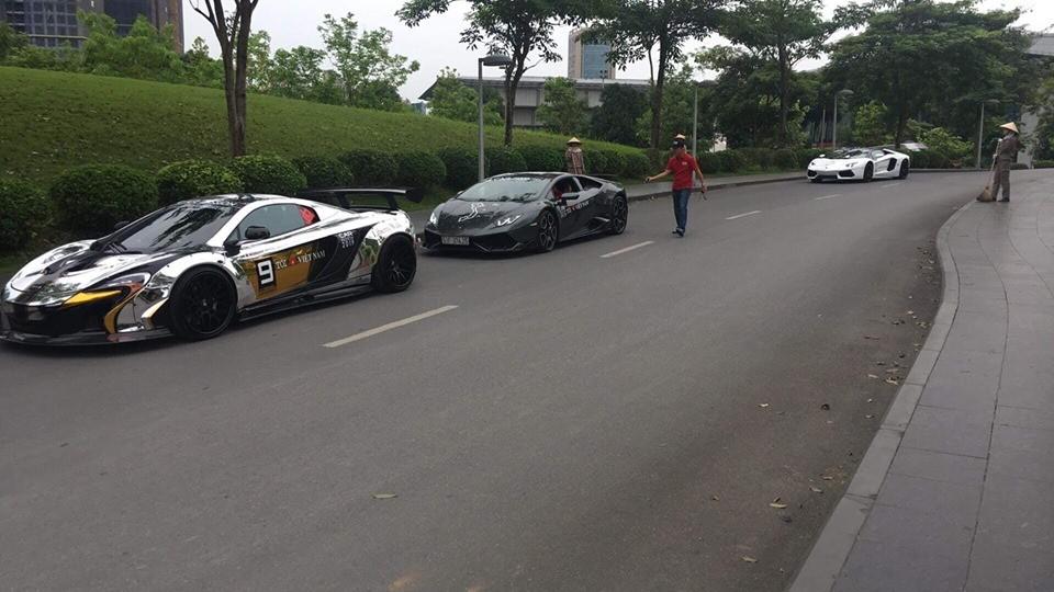 Lamborghini Huracan LP610-4 màu xám độ body kit chính hãng đỗ phía sau McLaren 650S Spider độ Liberty Walk của Dương Kon