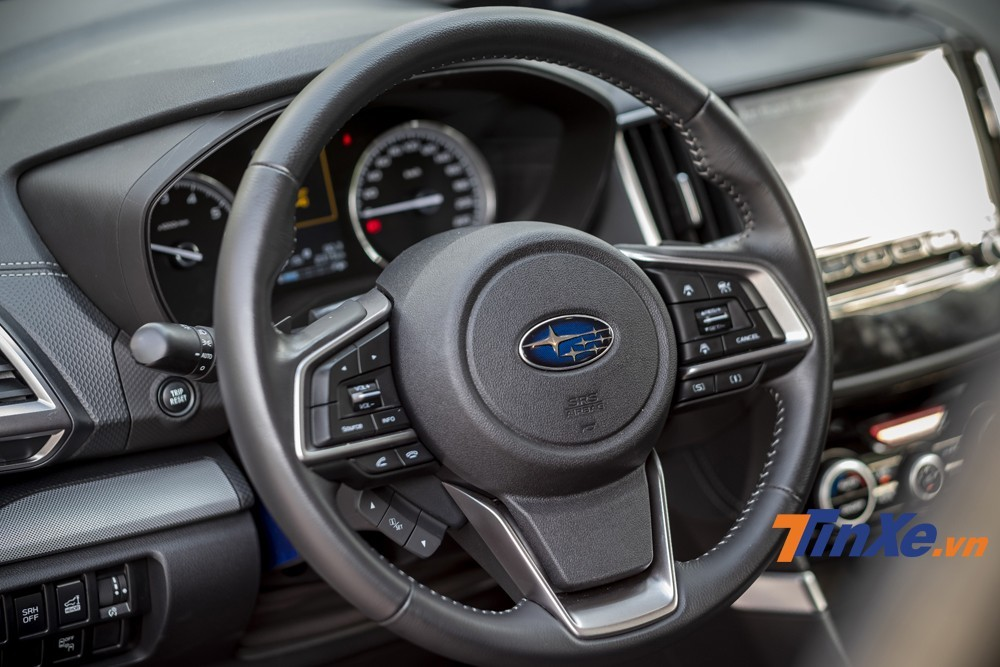 A sporty three-spoke steering wheel with lots of built-in features