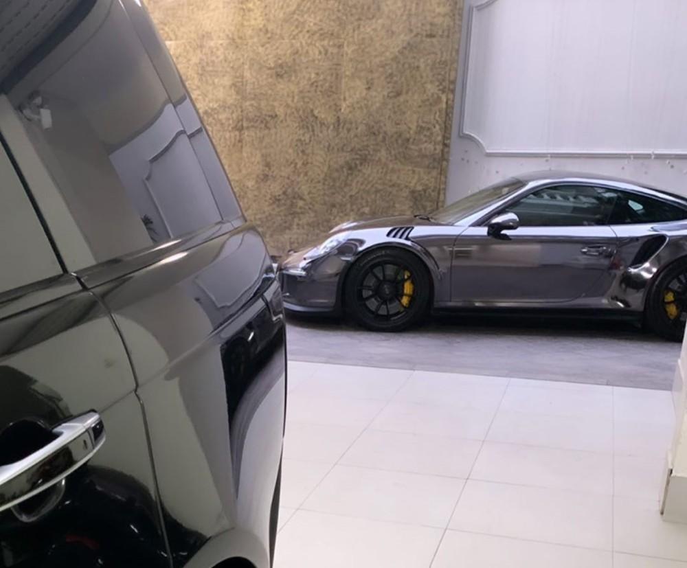 This Porsche 911 GT3 RS has an original orange paint color but now has black chrome decals