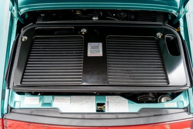 Beneath the rear engine cover of the 1997 Porsche 993 Turbo S is a 3.6-liter, six-cylinder, front-mounted engine block combined with two KKK K-24 turbochargers. The maximum power that the car can create is 450 horsepower, however, this Porsche 993 Turbo S is for the US market, so it only owns 424 horsepower.