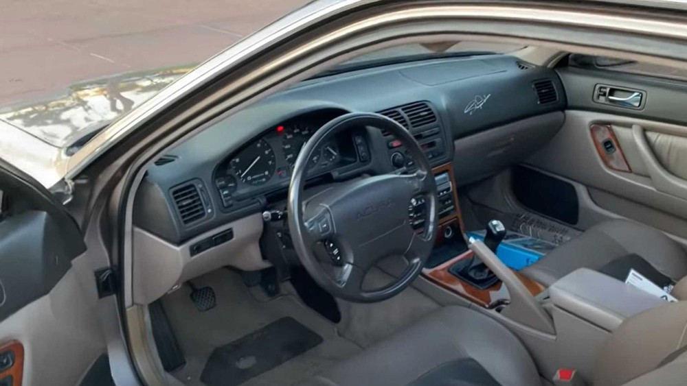 The interior of the 1994 Acura Legend LS went 921,751 km