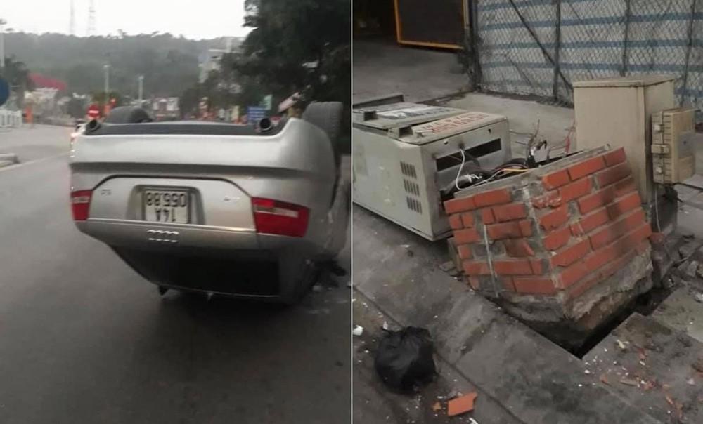 Chiếc ô tô hạng sang Audi đời cũ lật ngửa trên đường trong khi tủ điện bị tông đổ