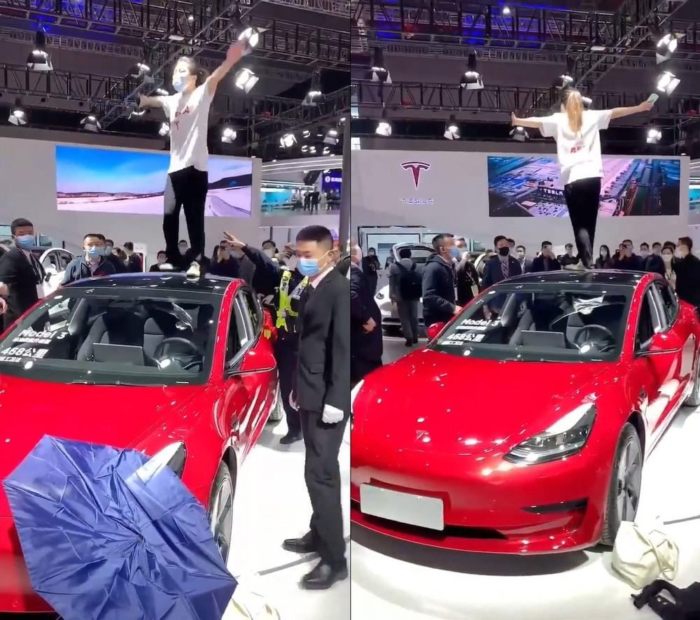 Người phụ nữ đứng trên nóc chiếc Tesla Model 3 trưng bày tại triển lãm Ô tô Thượng Hải 2021